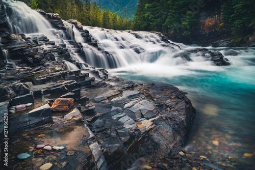 Foto op Aluminium Nachtblauw River cascading over rocks.