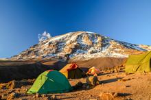 Stunning Evening View Of Kibo With Uhuru Peak (5895m Amsl, Highest Mountain In Africa) At Mount Kilimanjaro,Kilimanjaro National Park,seen From Karanga Camp At 3995m Amsl. Tents In The Foreground.