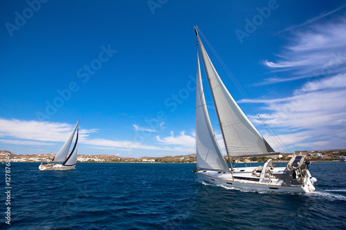 Luxury yachts at Sailing regatta in the wind through the waves at the Mediterranean Sea.