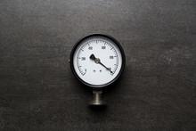 Old Pressure Gauge On Black Background