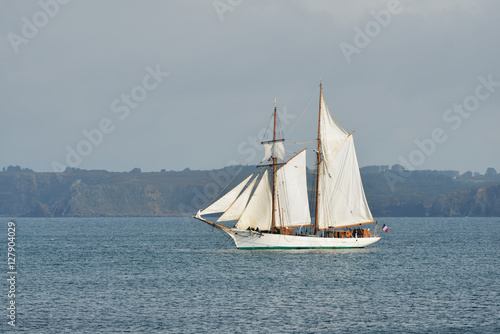 French tall ship with full sails at the coast of Brittany, France © Alex Stemmer