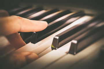 Fototapeta na wymiar male musician fingers playing on piano keys
