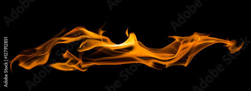 Photo sur Toile Feu, Flamme yellow flame long spark isolated on black