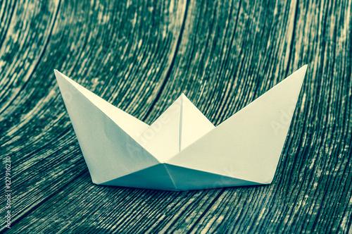Photo  Origami white paper boat