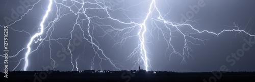 Fotografie, Obraz  Thunder, lightnings and storm over city at night.