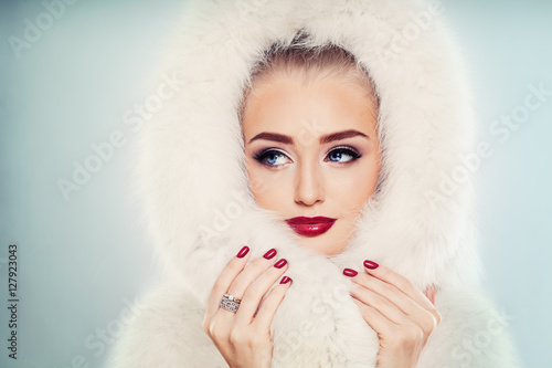 Winter Beauty. Fashion Portrait of Cute Winter Woman with Makeup Canvas Print