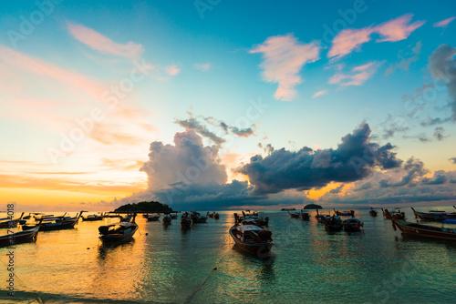 Acrylic Prints Horseback riding Wooden fisherman boat with sky background on sunrise