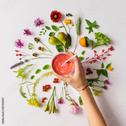 Various natural things neatly arranged in circle with smoothie Wall mural