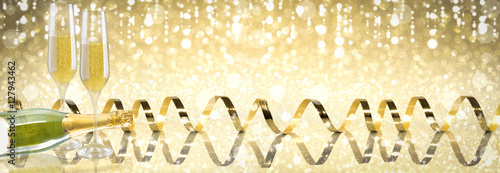 toast champagne new year golden background golden ribbon