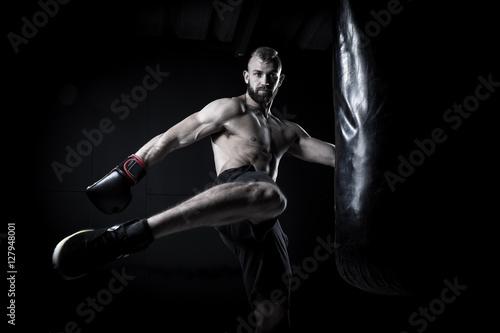 Foto op Plexiglas womenART Male Athlete boxer punching a punching bag with dramatic edgy li