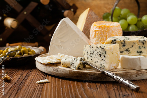 Fototapeta Mix cheese on wooden board.