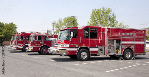 Parked fire trucks in a row. Horizontal. Wallpaper Mural