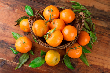 Mandarins tangerines basket. Top view.