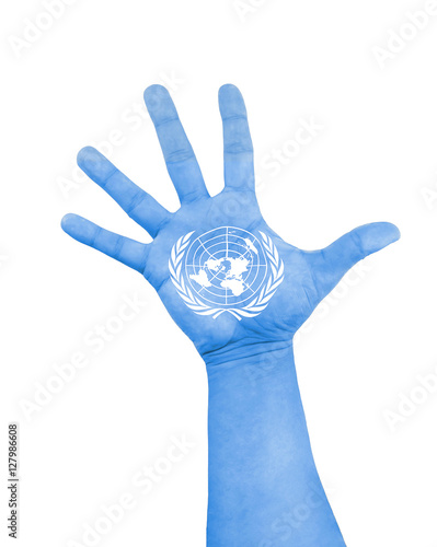 Fotografie, Obraz  open hand raised with color blue and white of flag of UN United Nations flag pai