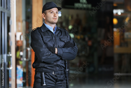 Canvas Print Security man standing indoors