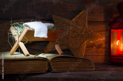 Fotografie, Obraz  Birth of Jesus with manger on the bible abstract christmas symbol nativity scen