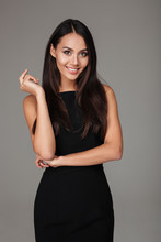 Classy Woman In Black Dress Standing And Looking At Camera