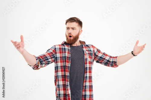Fotografie, Obraz  Confident bearded man in plaid shirt singing with arms raised