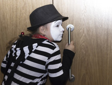 Girl As Mime Actress Listening At The Door