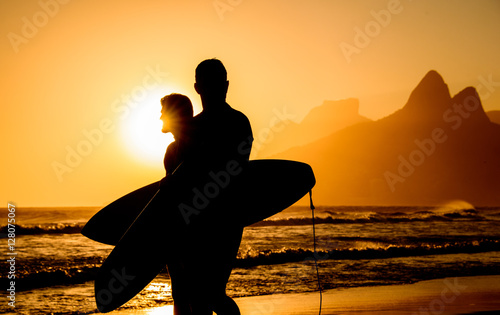 In de dag Rio de Janeiro Golden sunset in Ipanema Beach with Two Brothers, Dois Irmaos, Mountain and two surfers silhouettes, Rio de Janeiro, Brazil