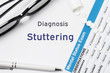 Diagnosis of Stuttering. Results of mental status exam, container with pills with inscription psychiatric diagnosis Stuttering on white background or white workplace psychiatrist or psychologist