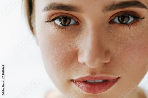 Fotografía  Closeup Of Beautiful Young Woman Face With Natural Makeup