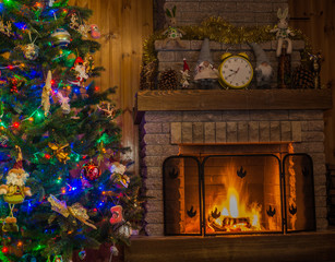 Christmas tree  in front of the fireplace, in a country house.