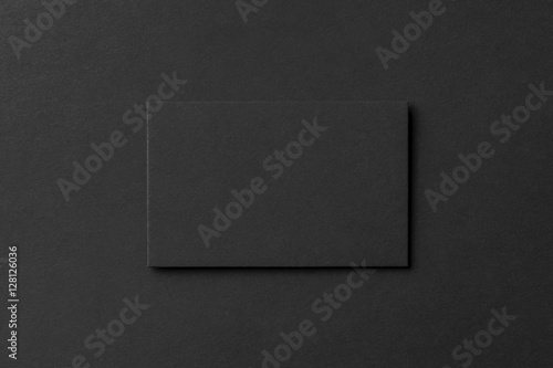 Photo  Mockup of blank business card at black textured background.