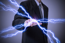 Business Person Generating Lightning From His Finger