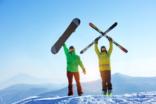 Skier And Snowboarder Mountain Top