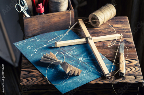 Vintage workshop with kite and elements to construct it