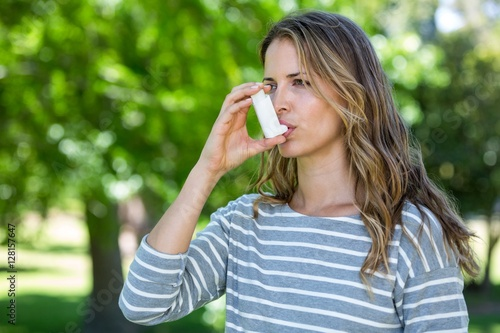 Woman using asthma inhaler Canvas Print