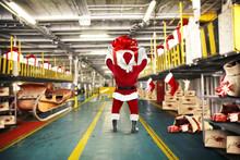 Santa Claus And Elf In Interior