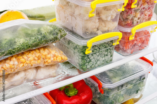 Fototapeta Frozen food in the refrigerator. Vegetables on the freezer shelves. obraz