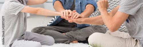 Fotografie, Obraz  Man holding his sons hands