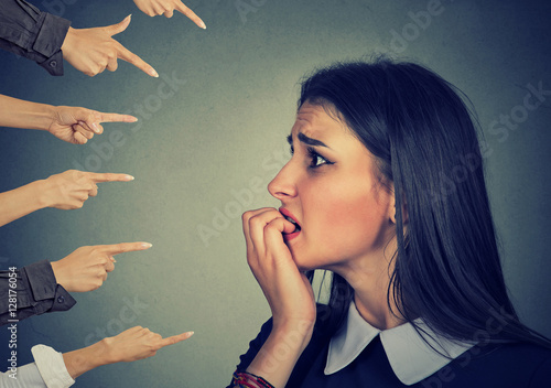 Fotografie, Obraz Anxious woman judged by different hands