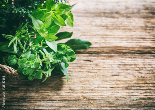 Variety of herbs on wooden background Canvas