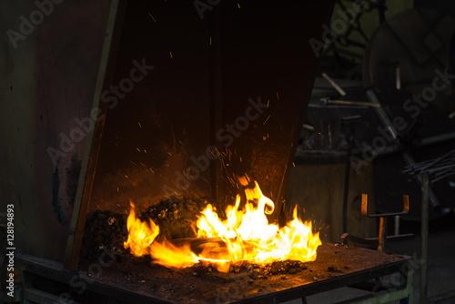 Staande foto Hoogte schaal The blacksmith making flames in smithy
