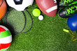 canvas print picture - Various sport tools on grass