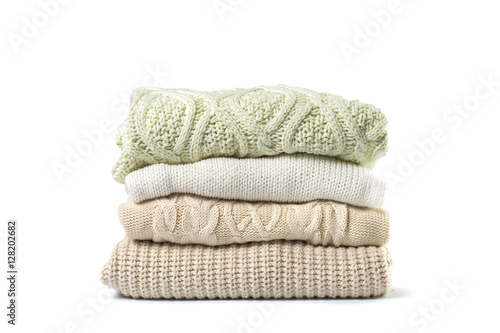 Obraz Stack of various sweaters isolated on white background - fototapety do salonu