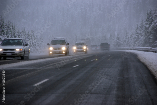Traffic moving through fog and snowstorm,Rocky Mountains