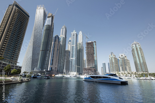 Canvas Prints Light pink Architecture theme. Dubai, marina bay at noon. Luxurious travel and living.. Business and finance concept. Futuristic architecture. Luxury apartments. High value properties.