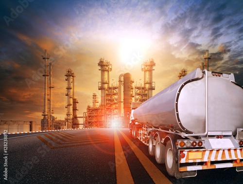Fotografie, Obraz  oil container truck and heavy petrochemical industries plant for