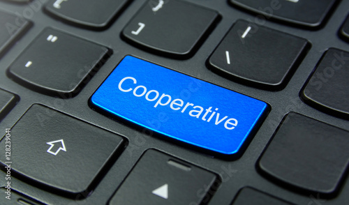 Valokuva  Business Concept: Close-up the Cooperative button on the keyboard and have Azure