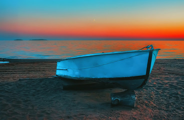 Fototapeta Morze Blue Boat On The Beach At Sunset