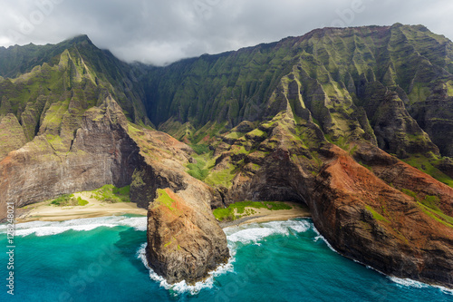 View of the monumental Na Pali Coast at Honopu Valley and Kalepa Ridge, aerial shot from a helicopter, Kauai, Hawaii Wallpaper Mural