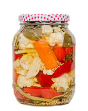 Jars With Pickles Containing Cauliflower, Cucumber, Red Pepper, Onions, Carrot, Celery, Isolated Close Up.