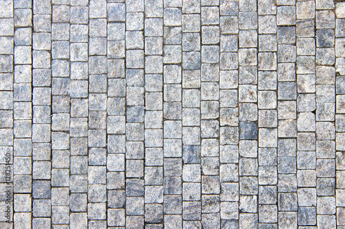 Granite cobblestoned pavement background, stone textured pattern Wallpaper Mural