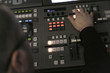 TV editor working with audio video mixer in a television broadca