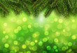 Christmas abstract background green blinking bokeh with pine tree.